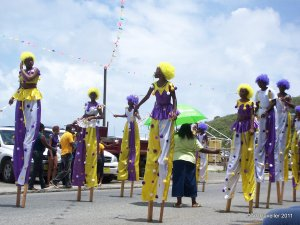 mocko jumbies in parade